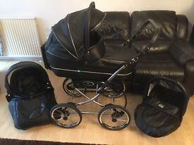 VIB black pram , immaculate condition , includes car seat