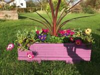 Purple berry planter with gorgeous flowers