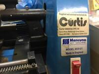Curtis key cutting machine