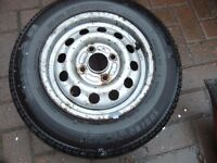 Ford Escort 13 inch steel wheel with unused tyre 155 80 R13 Tigar