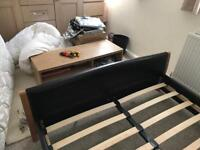 Double bed, faux leather head and footboard.