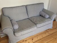 Lovely blue and white striped two seater sofa with washable covers. IKEA.