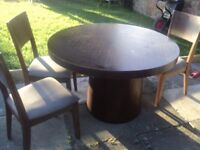 Large circular table with 4 chairs