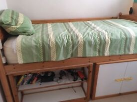 Cabin bed with shelves and desk