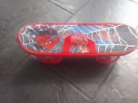 Childs spiderman skateboard and protection pack