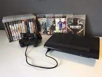 PlayStation 3 slim, huge 465 GB hard drive with 19 Games and 2 controllers.