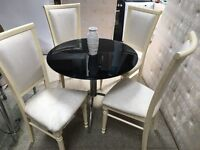 STUNNING BLACK GLASS DINNING TABLE WITH 4 HIGH BACKED WHITE CHAIRS