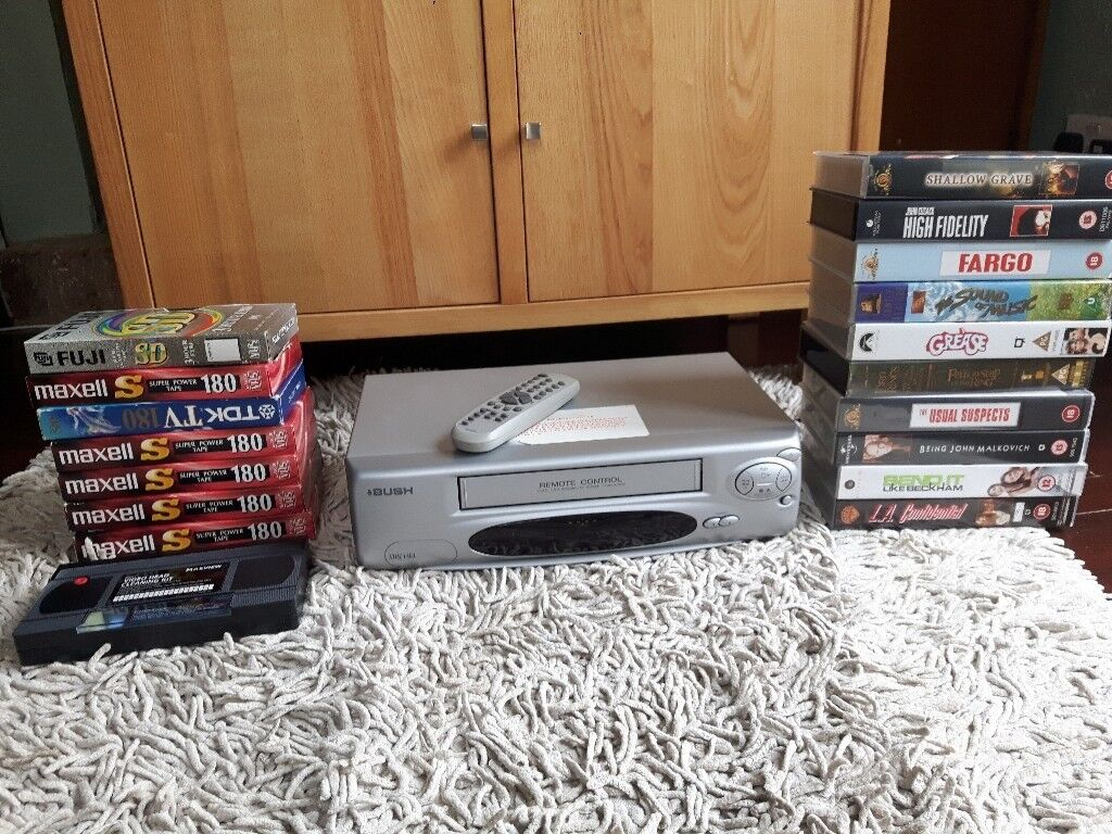 VHS Video Recorder with remote and a selection of videos