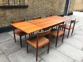 Mid-Century Danish Modern Teak Extending Dining Table and six chairs
