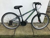 Apollo Switch bike, grip shift gears and Shimano brakes. Would suit age 8 upwards.