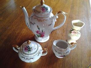 tea pot and cream and sugar also small vase