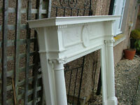 A large impressive antique painted pine and gesso fire surround