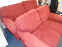 2 RED FABRIC SOFAS at Haven Trust's charity shop at 247 Radford Road, NG7 5GU