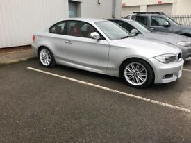 12 plate BMW 1 series coupe silver with red interior