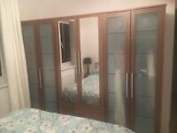 Wardrobe, chest of drawers & 2 bedside tables, excellent condition.