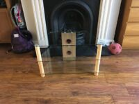 TV stand finished in Oak with Glass shelves
