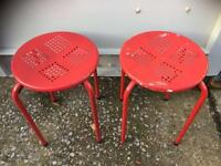 Pair of red metal stools ideal for christmas