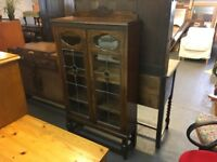 OAK BOOK CUPBOARD WITH LEADED GLASS.(Delivery available for a small fee)