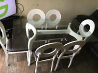 6 seater glass dining table with wood and leather chairs