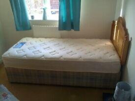 Single bed , brand new mattress , base and headboard
