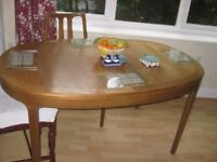 Nathan. Large oval extending dining table. teak seats up to 10