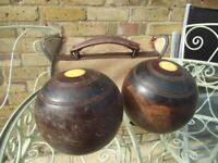 Two old wooden bowls in canvas carry case