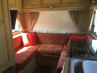 4 berth motorhome with U shaped lounge.