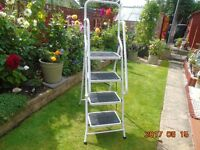 new 4 step ,step ladder , with 2 side hand rails , safety rubber on steel steps , made of tubeler