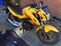 2016 yellow Honda cb125f perfect condition. With top box.