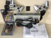 SILVER SONY PLAYSTATION 2 CONSOLE WITH 2 PADS, CABLES AND GAMES PS2 FULLY TESTED