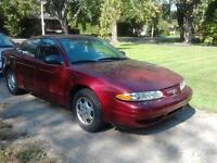$1,500. - Oldsmobile Alero Sedan 2001 - 2.4L twin cam 68,100km