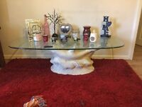 Coffee table dolphin stand and glass top excellent condition call me if your interested thanks......