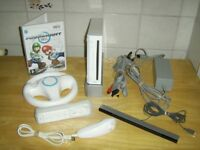 Wii Console with Mario Kart plus Wheel