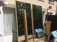 Sliding mirrored wardrobe doors