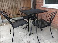 new cast iron table and chairs