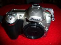 Nikon D50 Digital SLR, 6.1mp 18-55mm and 70-300mm Nikkor lenses plus battery charger