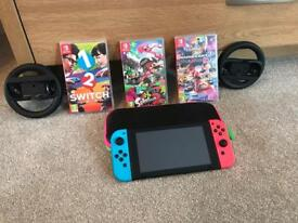 Nintendo switch bundle, neon blue and neon red AS NEW condition with 3 games