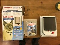 Cat flap works with collar tag, boxed and unused