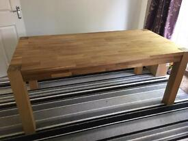 ** High quality real wood dining table from Homebase **