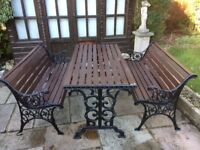 Cast iron table & benches for sale
