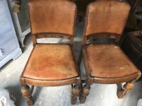 Two antique oak chairs