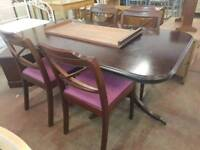 Large extending table and four chairs set