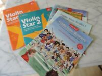 Five violin books with CDs for a beginner player