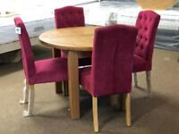 Ex-display**Solid oak round extendable table and 4 chairs - delivery available