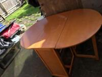 Round wood table size 130x90x75cm without chairs £15