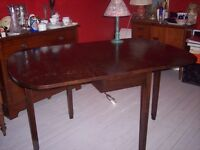 Solid oak dining table to seat 4-6 people, vintage, hinged flaps.