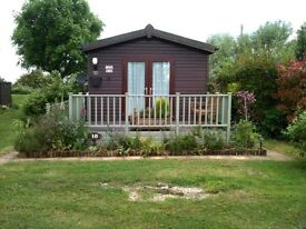 Brightlingsea leisure village 2 bedroom lodge for sale. Private garden area. Parking for 2 cars.