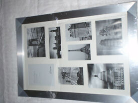 Photo Frame to take 8 photographs - silver colour - new still wrapped