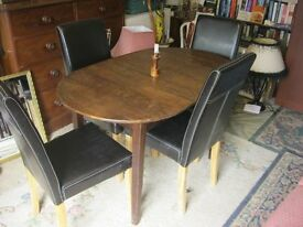OVAL OAK TABLE WITH 4 HIGH BACK BLACK LEATHERETTE CHAIRS. VIEWING/DELIVERY AVAILABLE