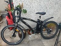 Wisper 905 SE Electric bicycle with light, helmet, high vis vest and b
